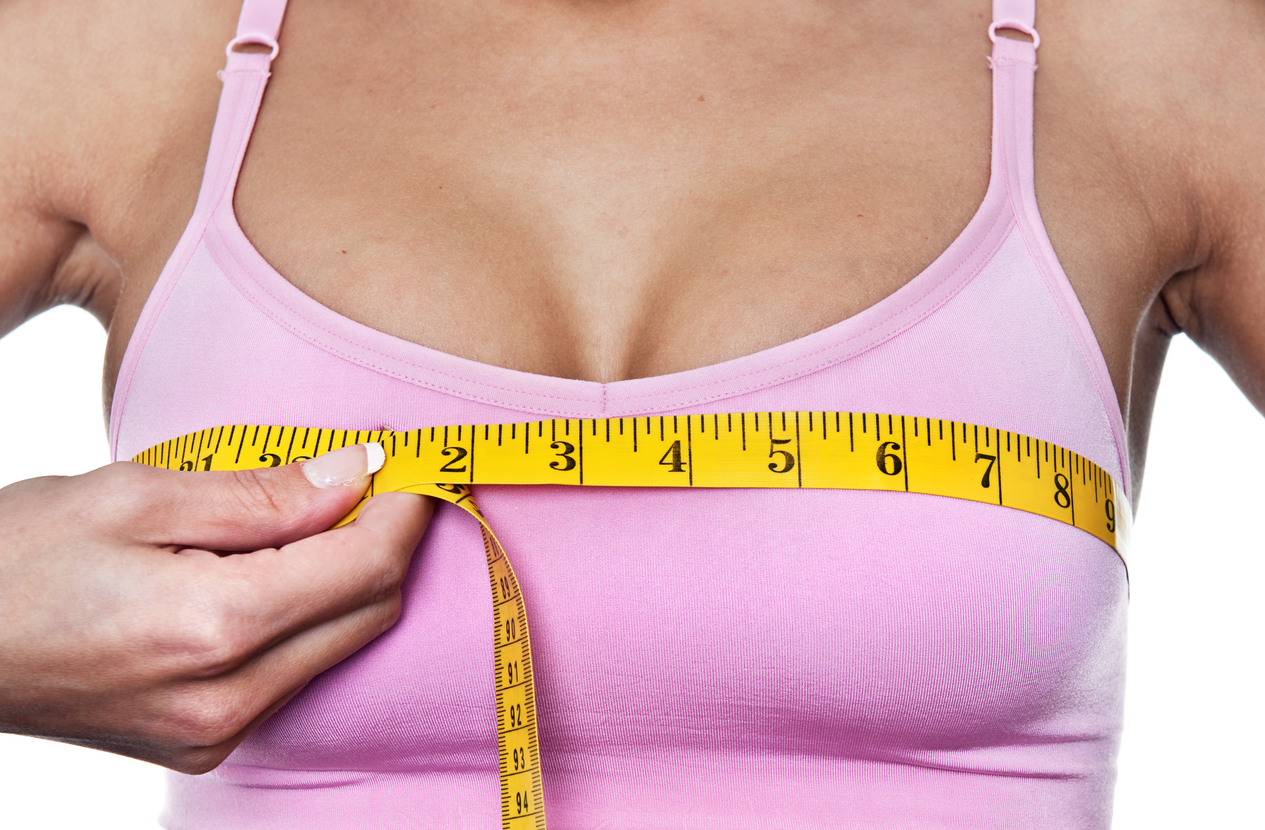 Woman measuring her bust line