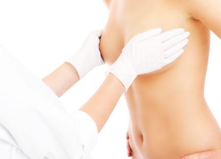 Doctor examining breast